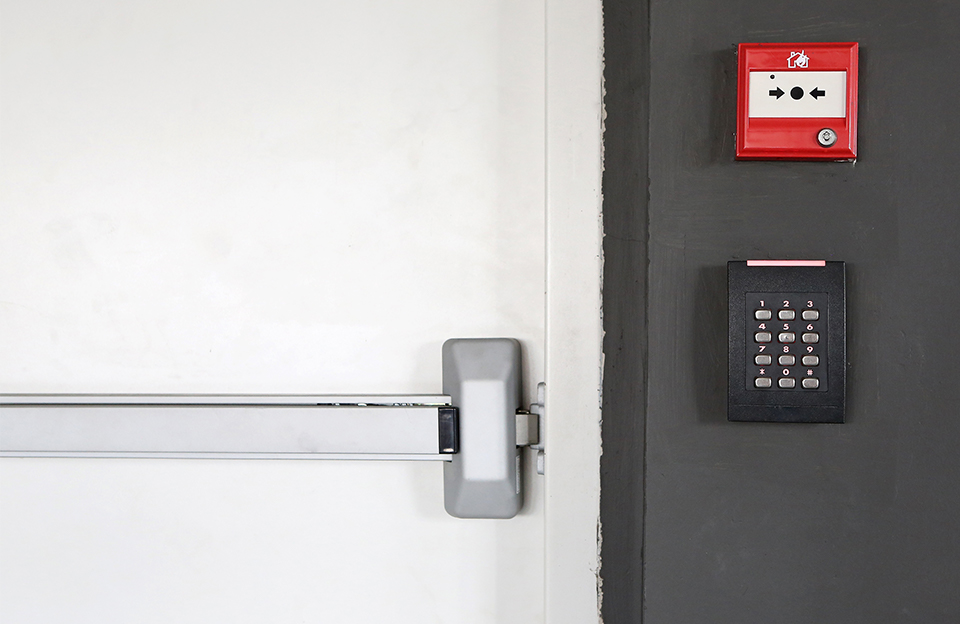 keypad and fire alarm on wall