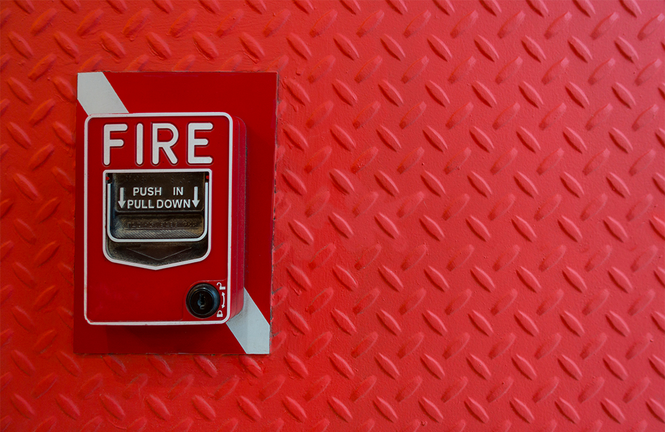 fire alarm on red wall