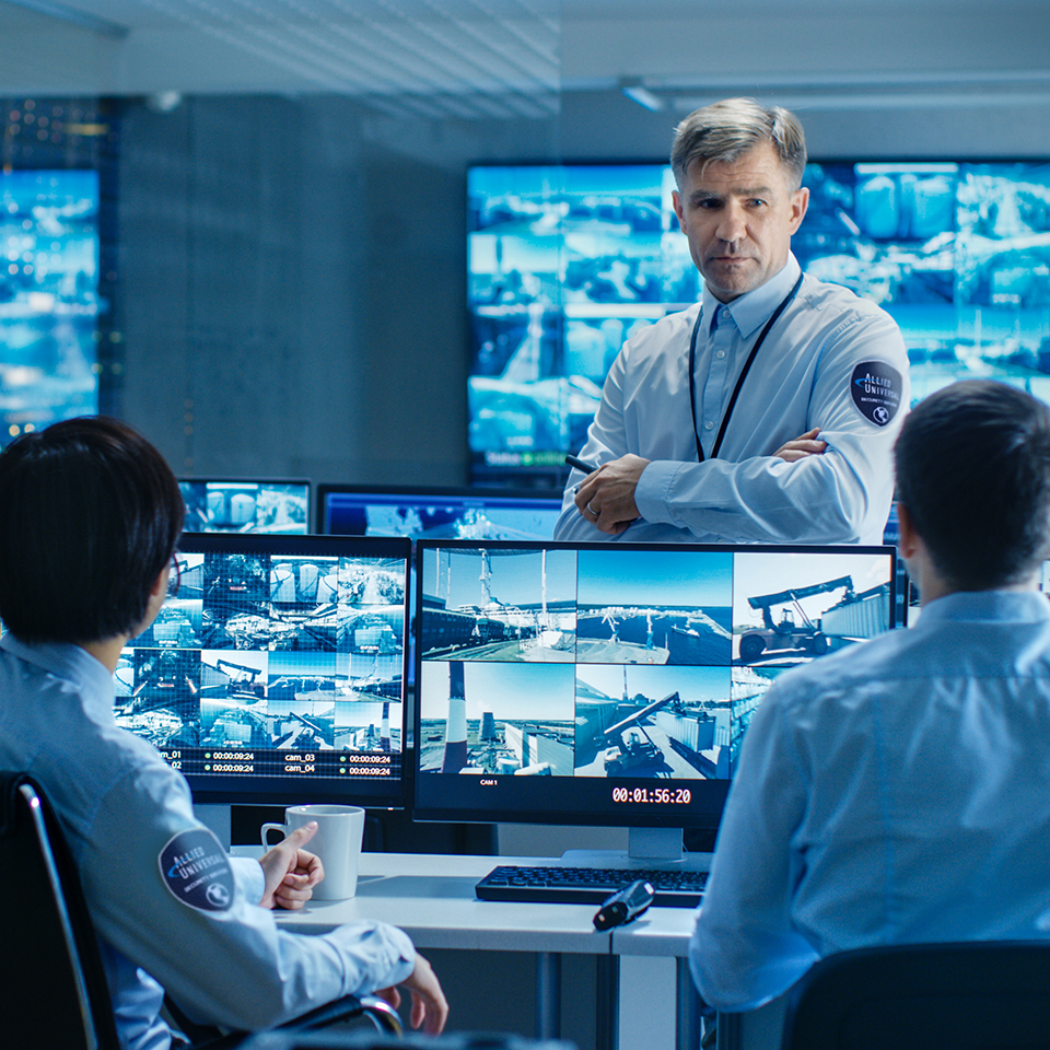 security professionals monitoring surveillance footage