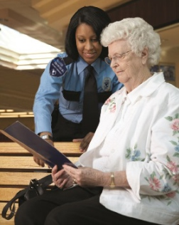 security professional assisting elderly