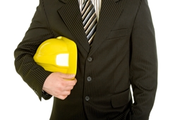 business professional holding hard hat