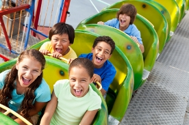 children riding roller coaster