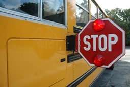 school bus with flashing stop sign