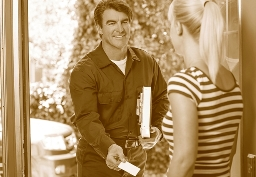 home repairman handing homeowner business card