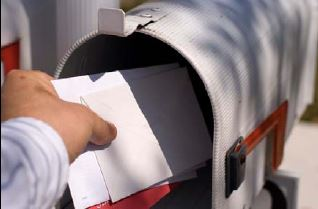 person grabbing mail from mailbox