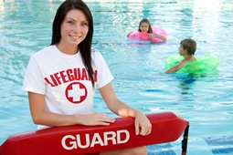 lifeguard standing in front of pool