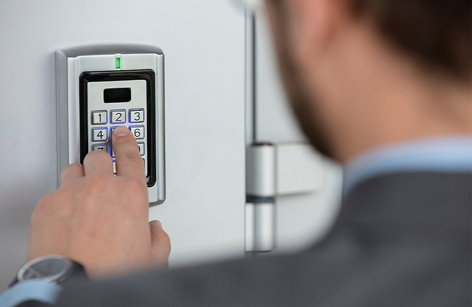Person Typing Security Code into Keypad